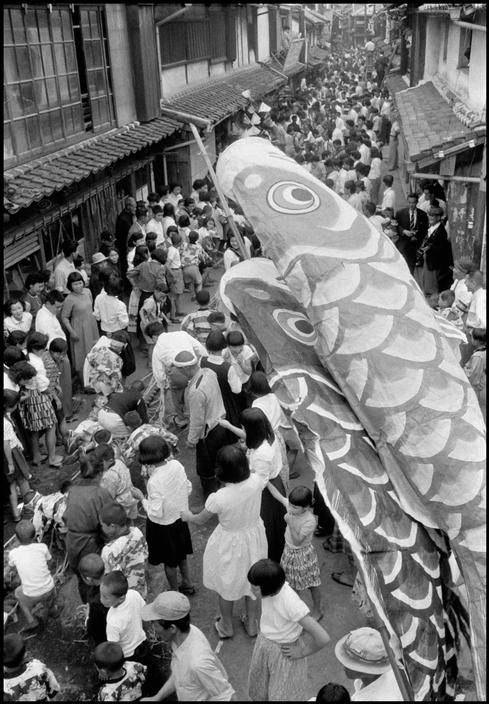 Koi-nobori over matsuri crowd, Japan, 1956, photograph by Dennis Stock.