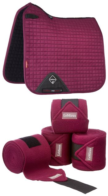 A stunning horse gift set combining the luxurious LeMieux ProSport Suede Dressage Square (D-Ring) in the beautiful plum colour way and the coordinating set of four plum LeMieux luxury fleece/ polo bandages.  Size of saddlecloth is large/ full and bandages are one size. A gorgeous horsey gift for the horse owner who is a dressage enthusiast