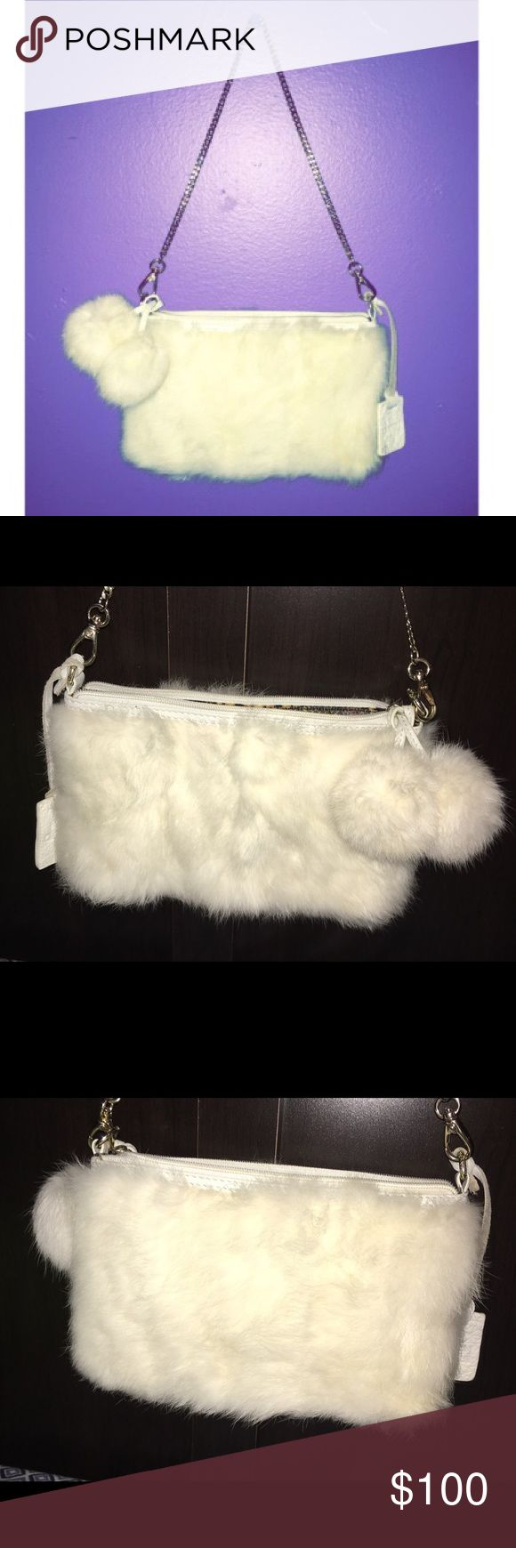 Rabbit Fur Handbag Snakeskin print lining, gold detachable chain, rabbit fur pom poms, rabbit fur & leather hand bag! Exactly as pictured. Flawless except for a very light discoloration of fur on the back right bottom corner, hardly noticable and as you can see its even unnoticable with flash from afar! Might come out but i know nothing about how to do so myself so i never tried in fear of messing it up lol. Purchased with matching boots seen in last photo, but i never use small bags Bags