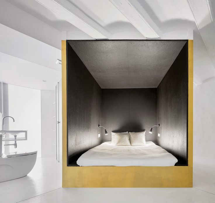 Raúl Sánchez Architects creates golden cubes inside duplex apartment