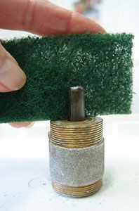 use ScotchBrite or steel wool to clean motor shaft