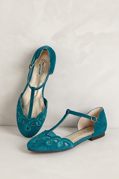 from anthropologie. teal blue suede T-strap flats with cut out detail
