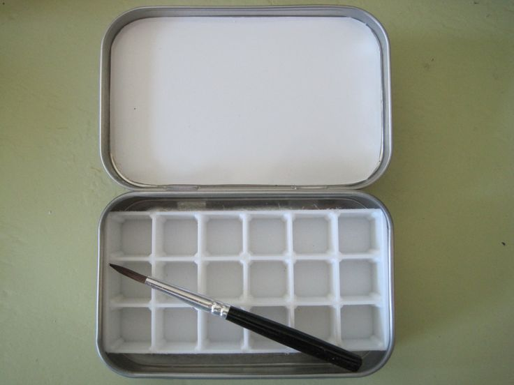 Small watercolor paint tin box w/ brush for travel - holds 18 of your favorite paints. $12.95, via Etsy.