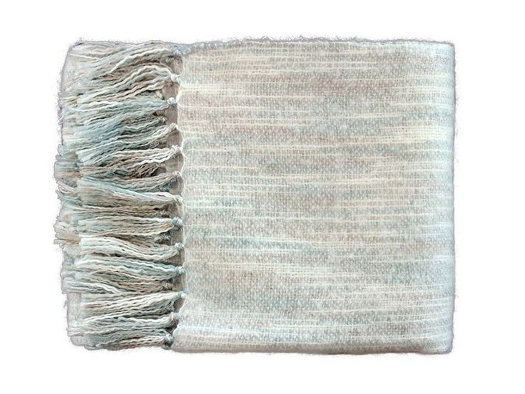 Symphony Mist Acrylic Throw - A soft acrylic tasseled throw that has been woven to give a beautiful multi-tonal effect with misty blue and grey hues.