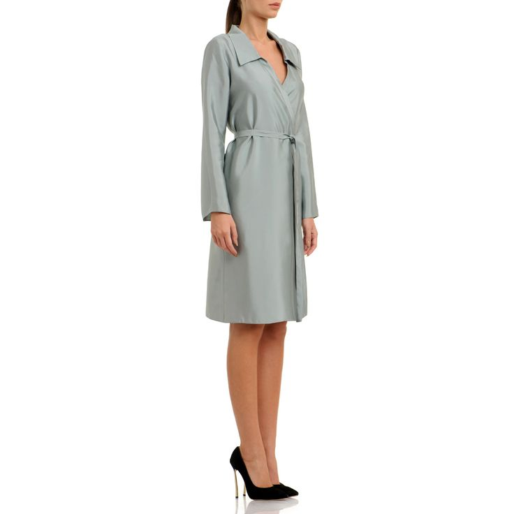The timeless style cut from satin has long sleeves, form-fitting design, cinched waist and adjustable V-neck. Works best with black heels to create a contrast of colour. Silver blue silk satin 100% silk Semi-Fluid textil Wash by hand The model is 176 cm tall and is wearing a size 38. If you need this product made to fit your needs and measures, book an appointment in our studio at i@laurahincu.ro for Private Fashioning.