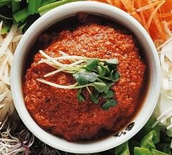 Korean: SSAM-JANG: Ssamjang is a mixed paste of gochujang (red chili pepper paste), dwenjang (fermented soybean paste) and other seasonings. It is frequently used as a condiment for wrapping a cooked meat and steamed rice within vegetable leaves such as lettuces, cabbages and sesame leaves. DIPPING SAUCE FOR BULGOGI