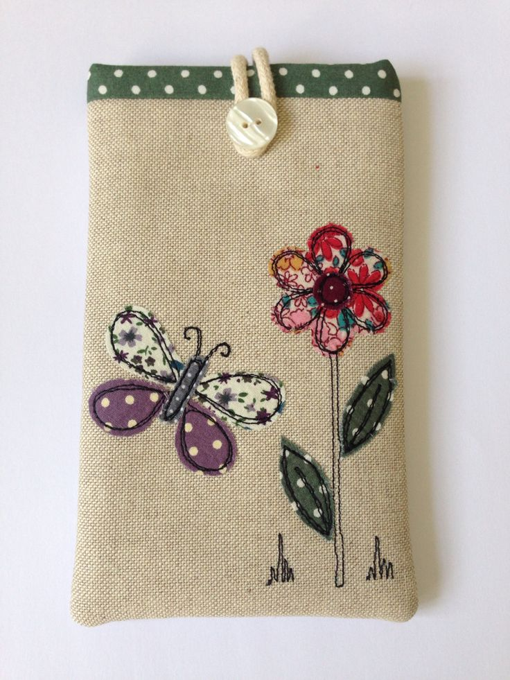 Handmade phone case decorated with appliqué and embroidery by Stitch Galore  www.stitchgalore.com