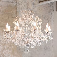 Classic Shabby Chic Chandelier. You can do it yourself by finding an old brass & crystal chandelier, just white-wash the brass. Beautiful!