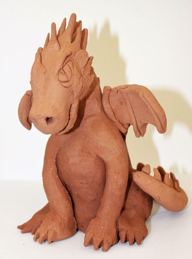 Dragon sculpture in clay, 25cm, in the round, handbuilt, Laura 9yrs