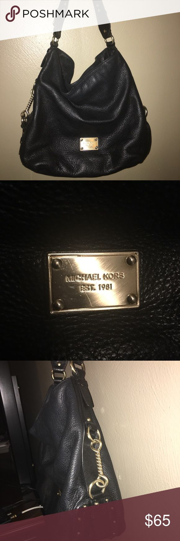 Michael Kors purse (good condition) Black MK purse. Gold chains on side. Small/medium size. Good condition. Michael Kors Bags