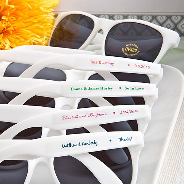 Place these white frame UV400 sunglasses personalized with the bride and groom's name and wedding date in wedding welcome gift bags or hotel gift bags for your destination wedding. Use sunglasses as favors for your summer outdoor wedding reception by placing a set of glasses on every seat of your ceremony venue or assign someone to hand a pair of sunglasses to each guest as they arrive. These sunglasses can be purchased at…