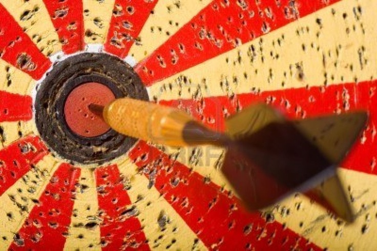 Darts is a standardized game as well as being a professional competitive sport; darts is also a traditional pub game, commonly played in the United Kingdom, across the Commonwealth, the Netherlands, Belgium, Republic of Ireland, the Scandinavian countries, the United States, Canada, and elsewhere.    The dartboard may have its origins in the cross-section of a tree.