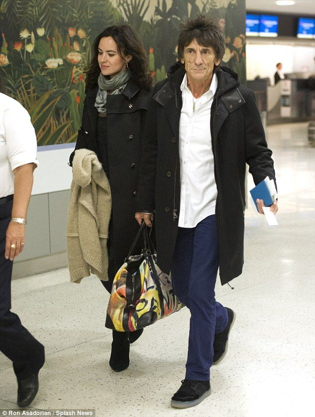 http://news-all-the-time.com/2014/05/05/ronnie-wood-and-wife-sally-humphreys-prepare-to-leave-new-york/ - Ronnie Wood and wife Sally Humphreys prepare to leave New York  - By Rebecca Davison  They've been married for a year and a half and Rolling Stones rocker Ronnie Wood, 65, and his wife Sally Humphreys, 35, are rarely seen without one another.  The loved-up pair were pictured making their way through JFK airport as they prepared to leave New York City...