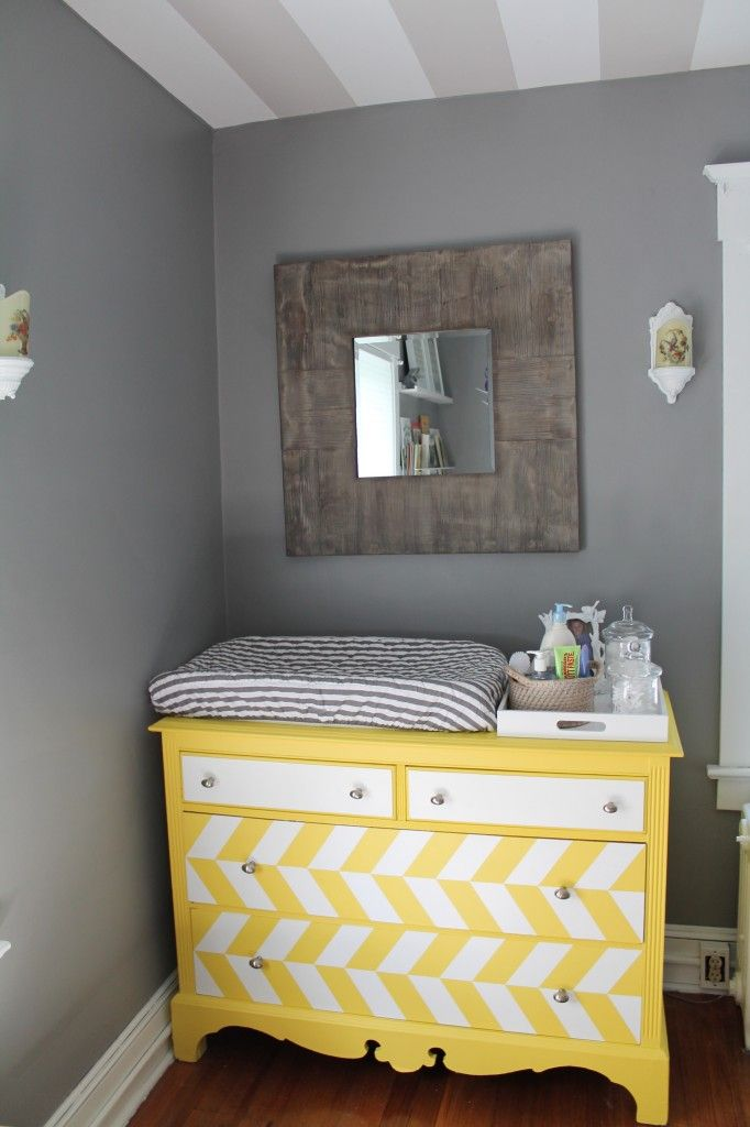 "And old chest of drawers refurbished to make a quirky yet stylish yellow changing station for a nursery. Quite a statement piece against the grey walls. And Joyce's ""TWO CENT'S WORTH IS""-- Yellow and grey seem to be real popular, but studies have concluded that the best colors for a nursery are red, black and white--not pastels."
