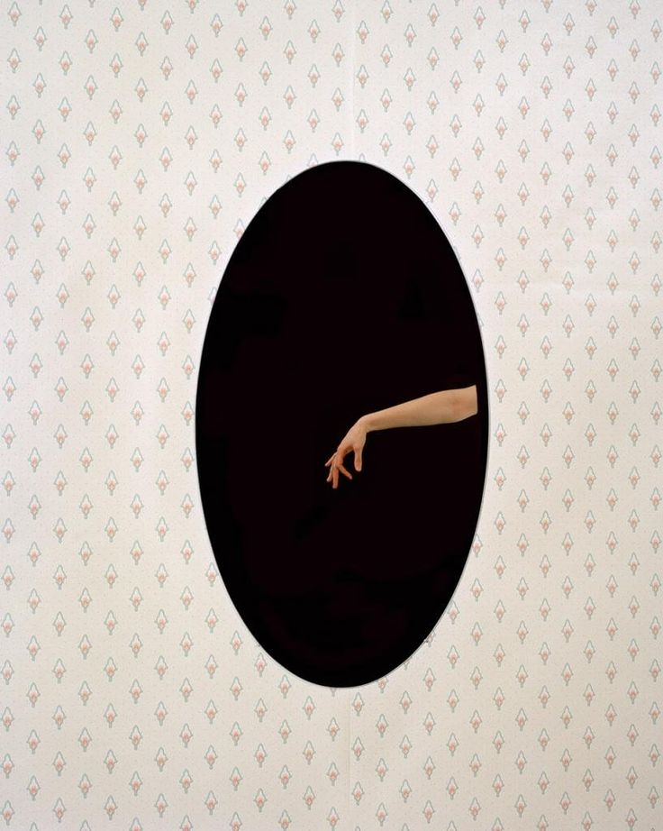 """14x11 in. Elise Victoria Louise Windsor Ovoid (left). The photograph """"Ovoid (left)"""" and """"Ovoid (right)"""" from the series mise en abyme (placing into infinity), are portraits of my arm waving into a mirror that reflects into the camera, that is nowhere in the shot. My hand engages the camera, but it appears as if I am stuck within a space where I cannot escape. The angle of the photograph is vital in creating the illusion as it seems logically unacceptable that the camera cannot be seen…"""