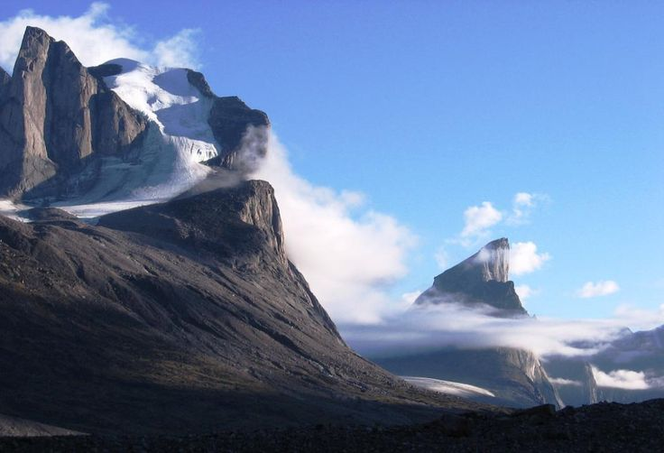 Mount Thor; elevation, 1,675 meters (5,495 feet) located in Auyuittuq National Park on Baffin Island, Nunavut, Canada. The mountain is famous for having Earth's greatest purely vertical drop at 1,250 meters (4,101 feet) at an average angle of 105 degrees. Beautiful