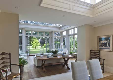 This conservatory extends from the dining area which incorporates a roof lantern with decorative timber panelling to the upstand
