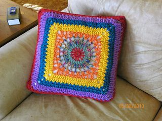 This colorful granny starts out round and then becomes a square. By just changing the order of the colors, you can crochet the perfect trio of pillows.