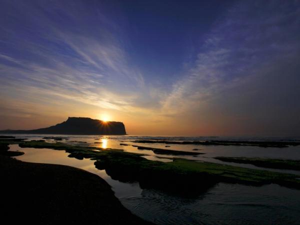 "Sunrise of Seongsan, Seongsan-eup, Seogwipo-si. Seongsan Ilchulbong Peak, literally meanning \\""sunrise peak in Seongsan,\\"" was named so for its spectacular view of the rising sun.  Jeju Island, South Korea"