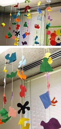 "Matisse Mobiles; ""drawing with scissors"" to make unusual organic shapes, cutting two at a time, and gluing with a string in between. Great mobile lesson."