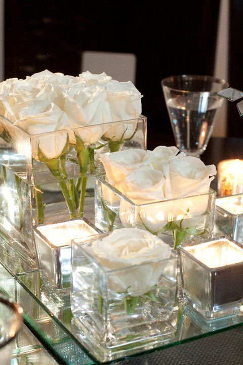 Clustered white table centres
