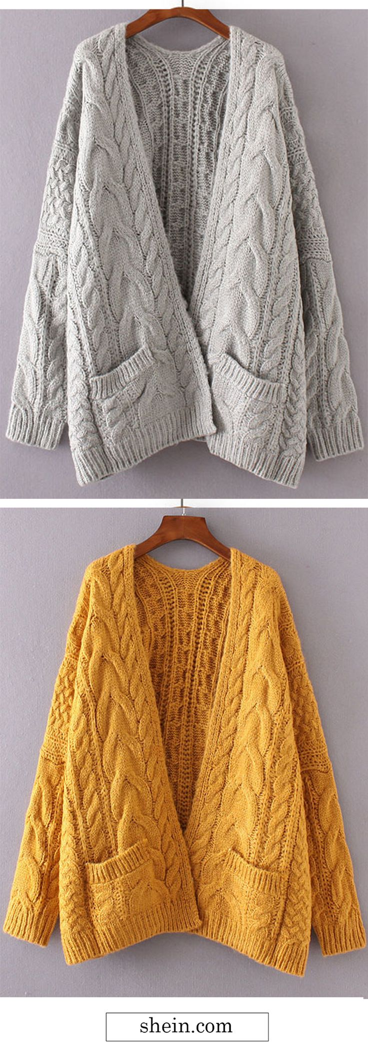 Drop shoulder cable knit cardigan.