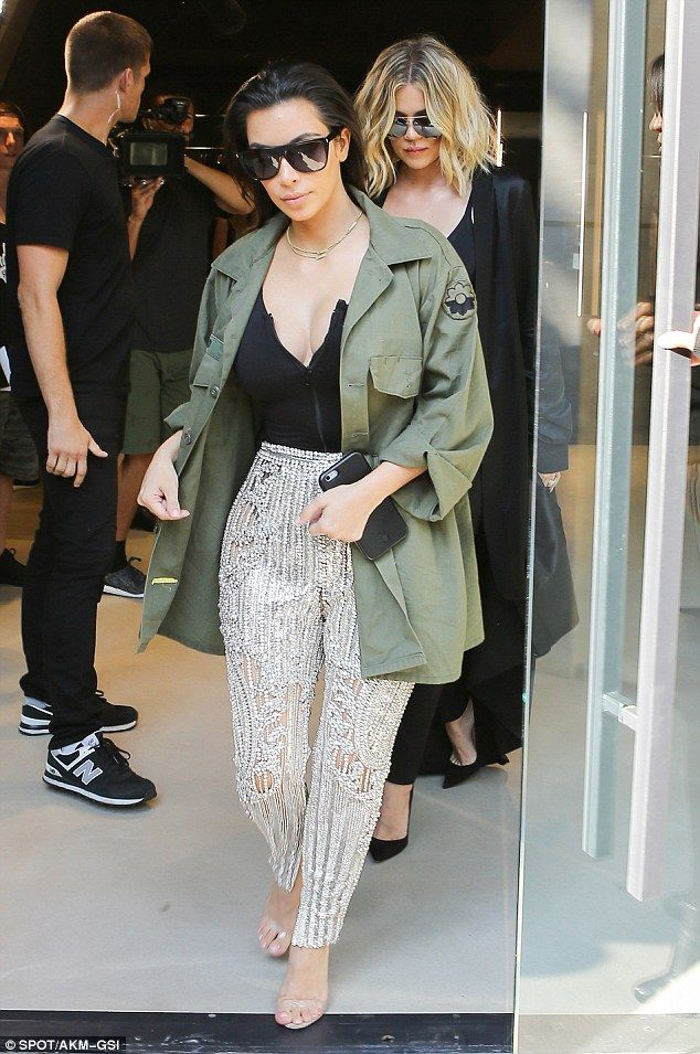 All that glitters! Kim Kardashian was hard to miss in her sparkling silver trousers as she...