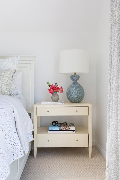 Simple And Comfortable Bedroom Designed With An Aerin Gannet Lamp Atop A Cream Nightstand Beside White Wooden Headboard Wooden Headboard Grey And White Bedding