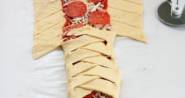 Cut Strips Of Dough On The Sides And Fold One Over The Other.