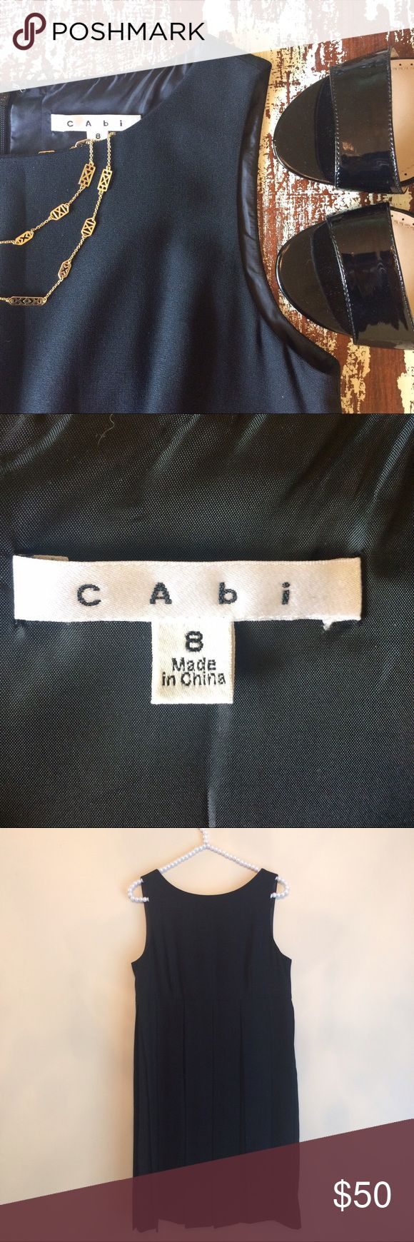 """CAbi Black Flapper Dress #236 size 8 Black Flapper Dress #236 size 8 by CAbi Skirt inside is straight.  Measure: length 37"""", bust 36"""", waist 34"""", hips 40"""" Material: Polyester and acetate  Condition: Like new CAbi Dresses"""