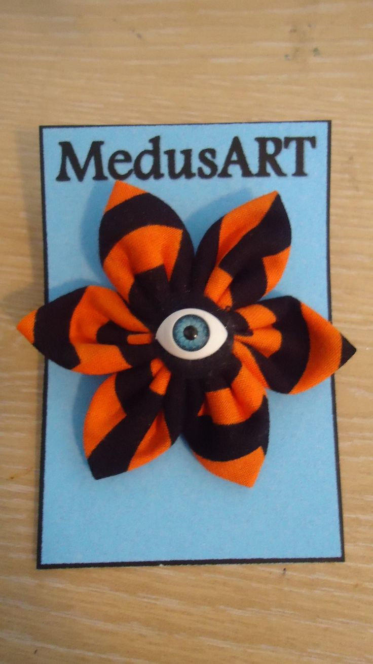 Handmade Black and Orange Fabric Flower Brooch - $7.00. (Postage not included)  This is made to order. Please allow 1-2 days for me to make it up.  Due to pattern on fabric designs may vary slightly from the original.