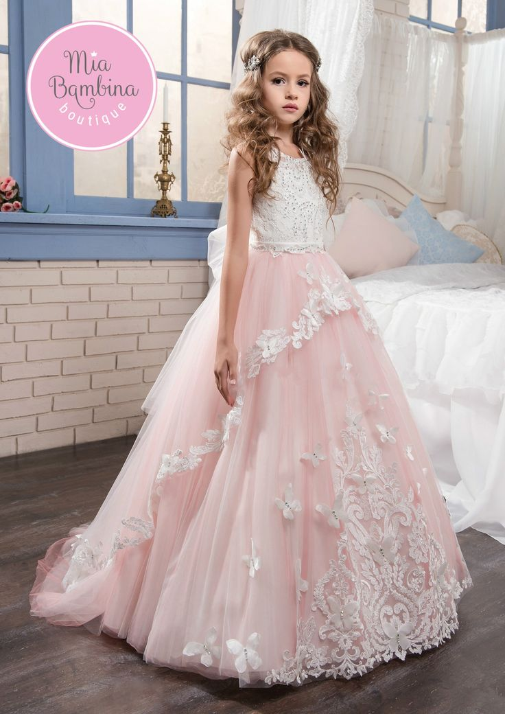 Let your girl live her fairytale fantasy with this magical Ontario flower girl dress. Exquisite lace appliques adorn the fitted bodice and the sheer tulle skirt with its overskirt detail. The outer la