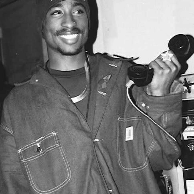 Tupac smiling like a saint