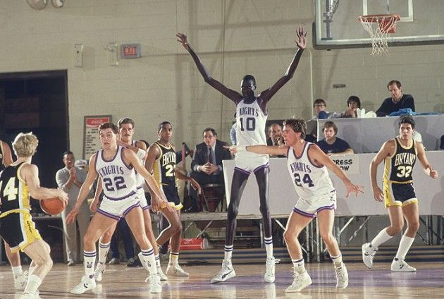 """Here's A Photo Of Manute Bol Playing Defense. An oldie but goodie: here's the late Manute Bol (yes, Mr. """"Throw It Over The Shoulder"""" Himself) playing defense for the University of Bridgeport in 1985."""