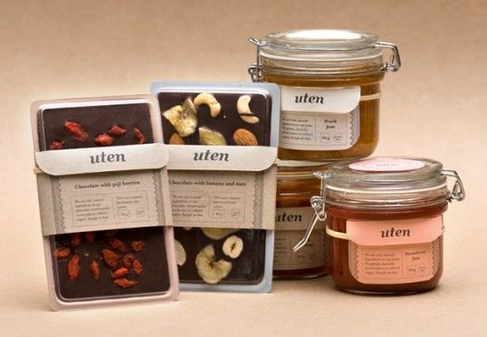 """""""Uten is a Norwegian product line containing natural and seasonal jams, chocolates and condiments that are home made and free from gluten, milk, soy, refined sugar and preservatives. The packaging encourages the buyer to re-use, with recipes and tips inside the label folder. When the jar is empty and the chocolate is eaten, simply take of the tags (the string makes sure you'll have no sticky glue marks!) and use the empty containers to create your own delicious foods."""""""