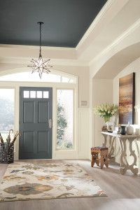 Make your front door the star of your foyer. Dress it up with a fresh coat of paint to contrast the surrounding walls.