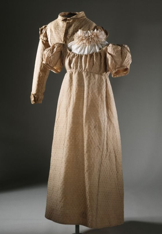 Girl's Dress and Spencer Jacket England, circa 1817 Costumes; ensembles Brocaded silk/ wool blend .1) Dress center back length: 33 1/2 in. (85.09 cm); .2) Spencer center back length: 9 in. (22.86 cm) Gift of Helen Larson (AC1997.191.40.1-.2)| LACMA Collections