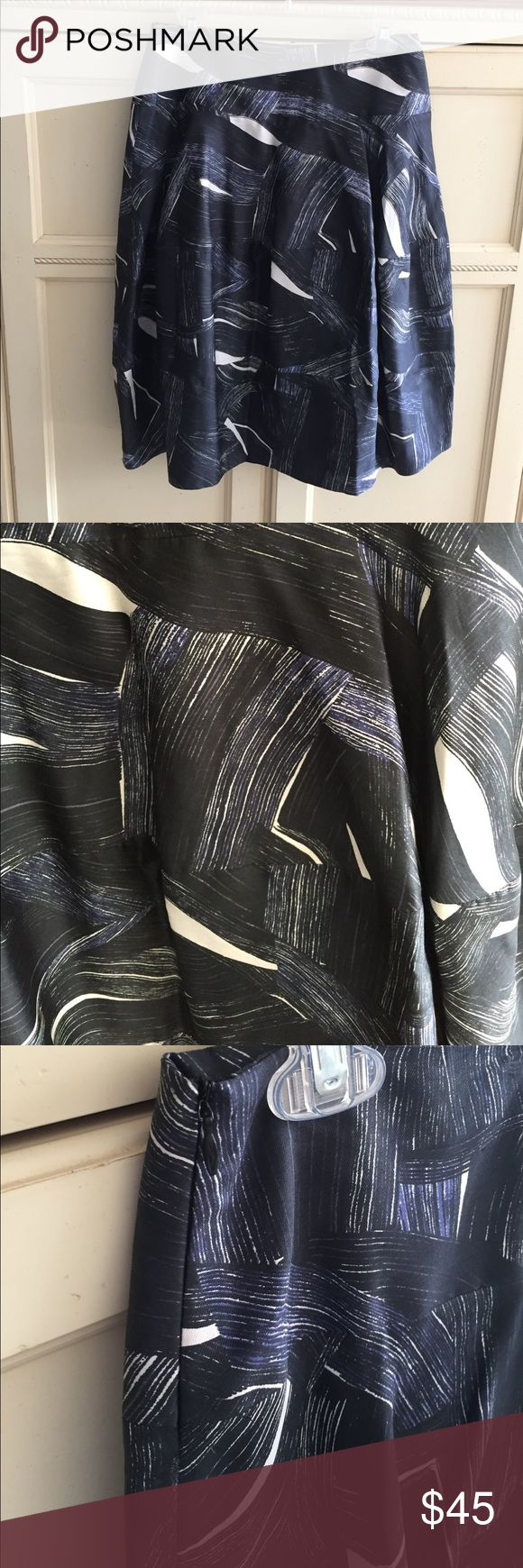 Nicole Farhi silk skirt Gorgeous Nicole Farhi silk skirt in shades of blue and black with dove gray highlight. Size 14 UK which translates to a size 10 US NICOLE FARHI Skirts