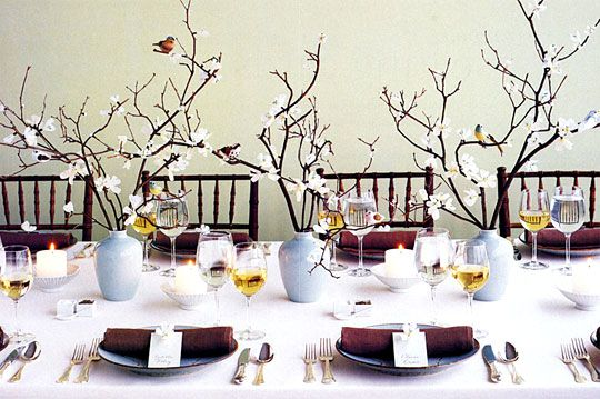 Twigs with birds in vases