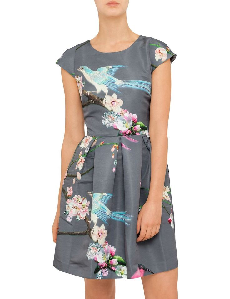 The Zaldana Flight Of The Orient Dress from Ted Baker that will add timeless feminine beauty to your wardrobe. It features a full skirt with pleats, capped sleeves and a zip back fastening. The print is a lovely mix of birds and floral.