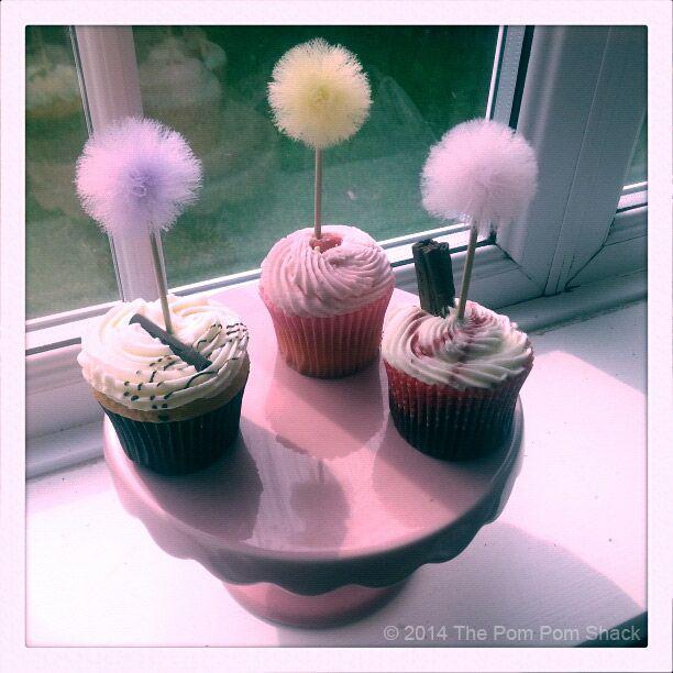 The sweetest pom pom cake toppers from https://www.facebook.com/thepompomshack.