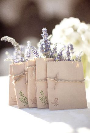 lavender pockets in brown paper bags (which can be stamped) as wedding favors... these can also include a seed packet, or lavender tea bags for two tied to the outside of the bag with jute