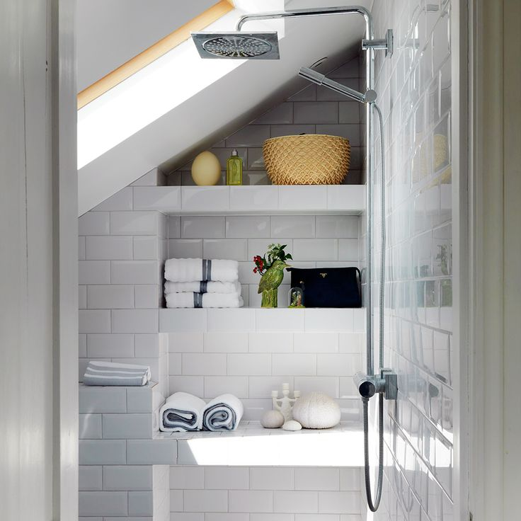Compact wet room with built-in tiled shelves wet rooms