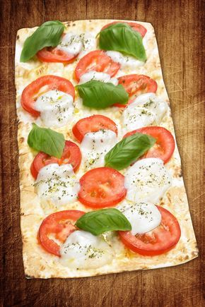 1 Flatout® Flatbread Artisan Thin Pizza Crust ½ medium tomato, sliced 1/2 cup mozzarella, shredded 6 fresh basil leaves 2 Tbsp. balsamic vinaigrette dressing Place flatbread on a cookie sheet. Bake at 350 for two minutes. Remove and top with cheese, tomato and basil. Bake at 350 for four minutes. Remove from oven. Drizzle with Continue Reading...