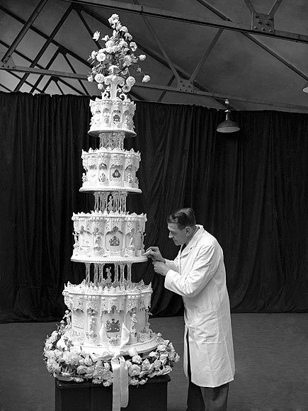 Holy crap - Queen Elizabeth's wedding cake was 9 feet tall and weighed 500 pounds. Someone knows how to get their cake on.