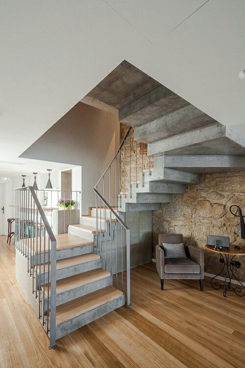 Love the mix of concrete stairs,steel rail, wood and stone