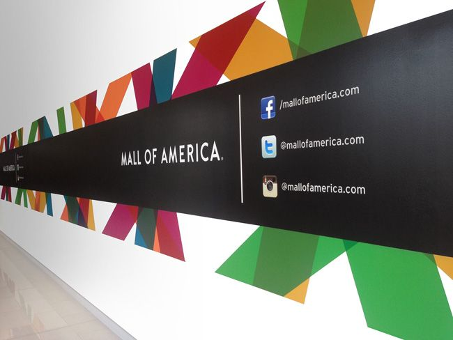 Mall of America - The star logo is a bit naff (but well executed), but I love the application of the branding, great use of colour - RL