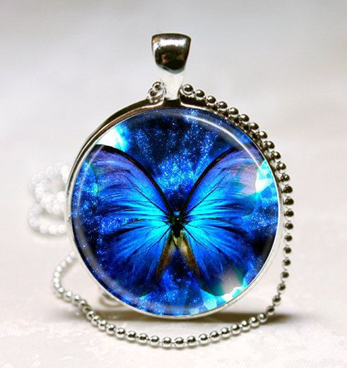 Blue Glowing Butterfly Handcrafted Glass Tile Necklace Pendant. $8.95, via Etsy.