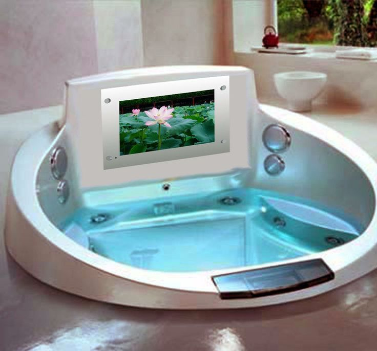 Bathtub with tv and jacuzzi fits two people romantic for Tv in bathroom ideas