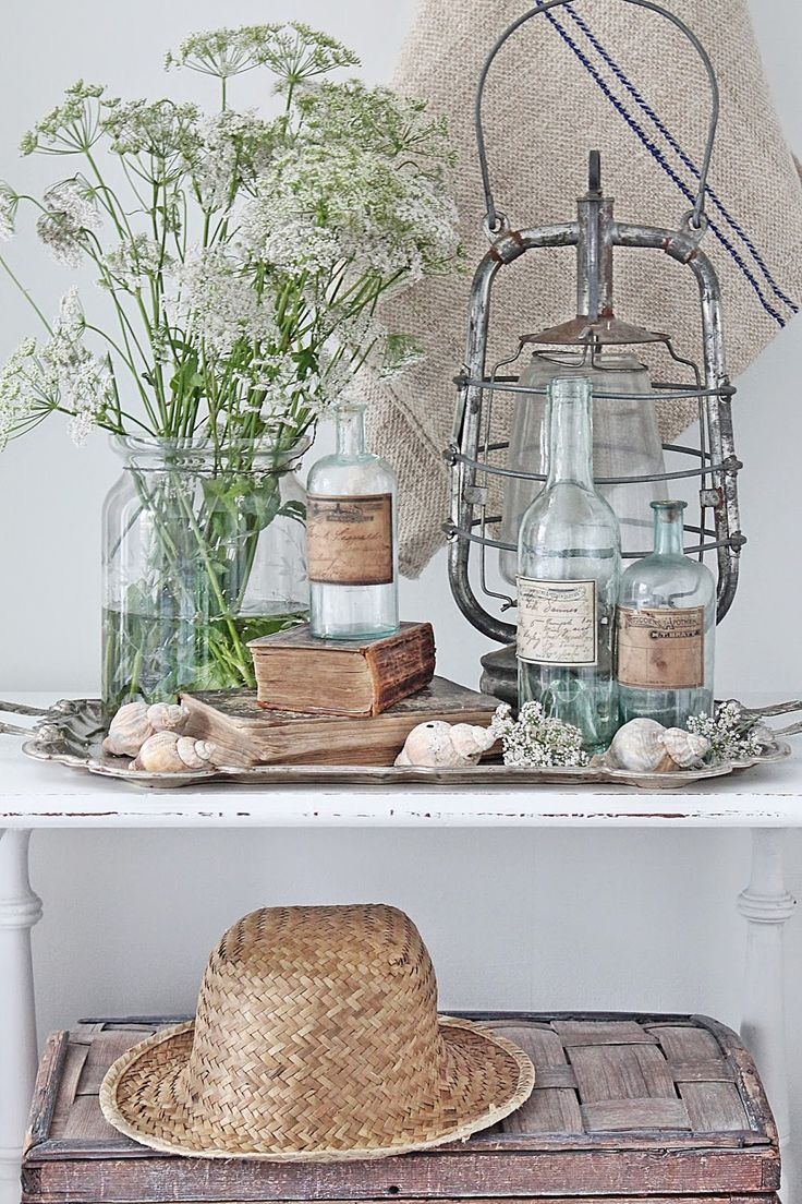Rustic display using natural elements and distressed/old man-made items